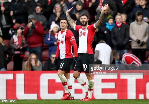 Charlie Austin of Southampton celebrates scoring the 2nd Southampton goal with Dusan Tadic of Southampton during the Premier League match between...