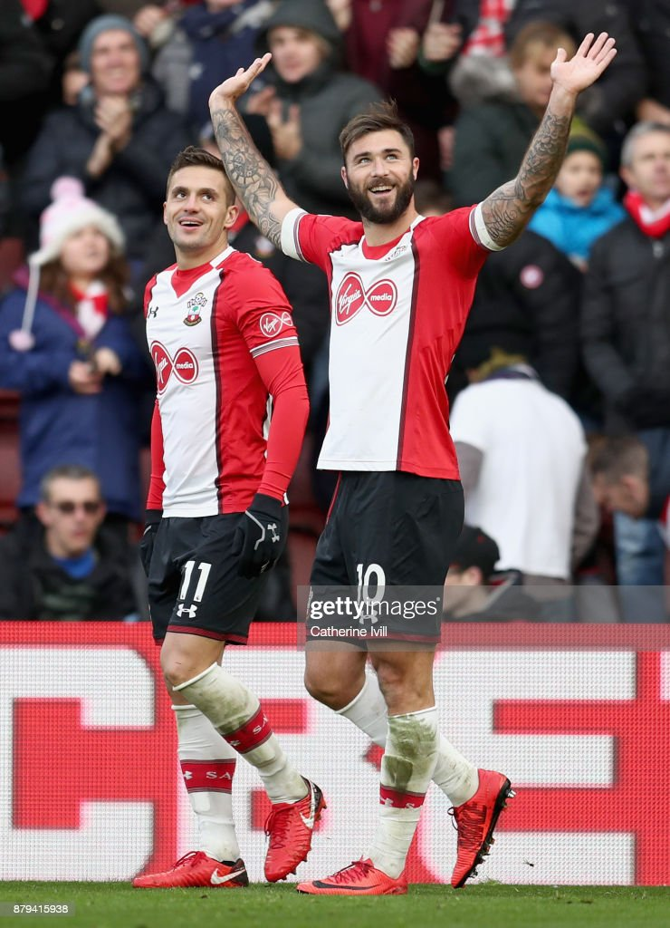 Charlie Austin of Southampton celebrates scoring the 2nd Southampton goal with Dusan Tadic of Southampton during the Premier League match between Southampton and Everton at St Mary's Stadium on November 26, 2017 in Southampton, England.