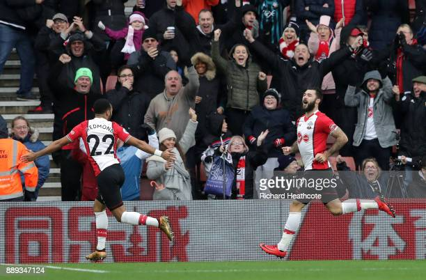 Charlie Austin of Southampton celebrates scoring the first Southampton goal with Nathan Redmond of Southampton during the Premier League match...
