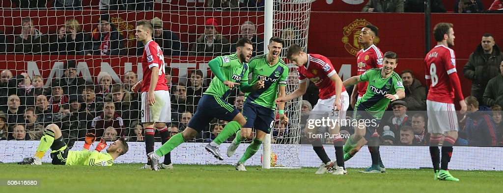 Charlie Austin of Southampton celebrates scoring their first goal during the Barclays Premier League match between Manchester United and Jose Fonte at Old Trafford on January 23, 2016 in Manchester, England.