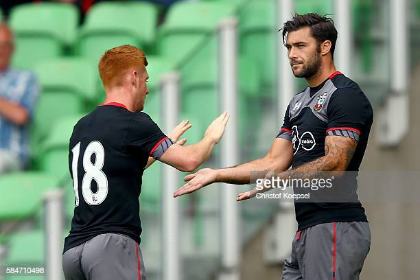Charlie Austin of Southampton celebrates the first goal with Harrison Reed of Southampton during the friendly match between FC Groningen an FC...