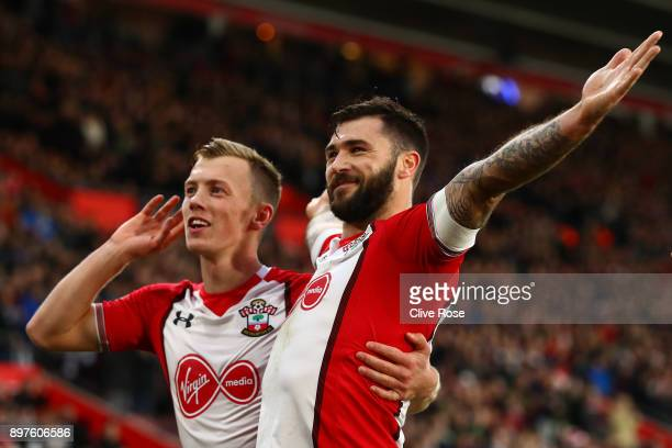Charlie Austin of Southampton celebrates with teammate James WardProwse after scoring his sides first goal during the Premier League match between...