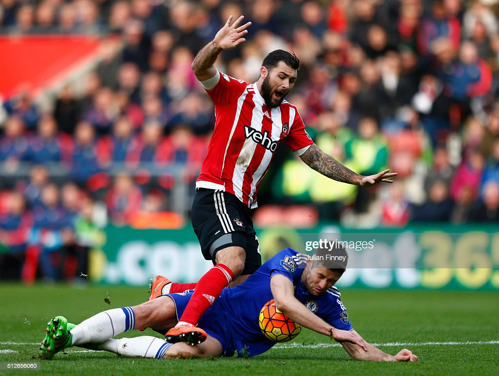 Charlie Austin of Southampton is challenged by Gary Cahill of Chelsea during the Barclays Premier League match between Southampton and Chelsea at St Mary's Stadium on February 27, 2016 in Southampton, England.