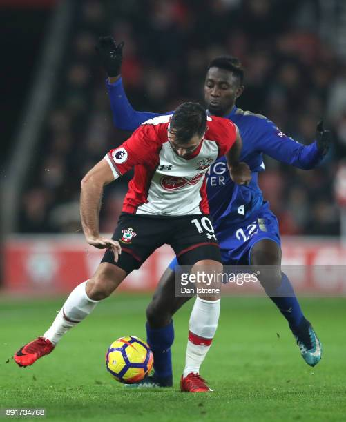 Charlie Austin of Southampton is challenged by Wilfred Ndidi of Leicester City during the Premier League match between Southampton and Leicester City...