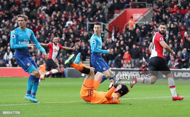 Charlie Austin of Southampton looks back after scoring his side's first goal during the Premier League match between Southampton and Arsenal at St...