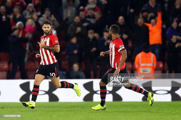 Charlie Austin of Southampton runs to the bench to celebrate a goal which was then disallowed during the Premier League match between Southampton FC...