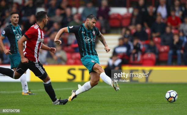 Charlie Austin of Southampton scores a goal during the Pre Season Friendly match between Brentford and Southampton at Griffin Park on July 22 2017 in...