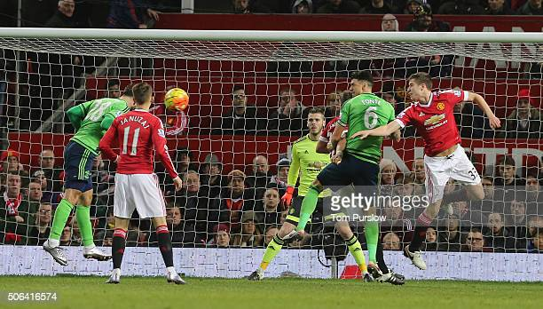 Charlie Austin of Southampton scores their first goal during the Barclays Premier League match between Manchester United and Jose Fonte at Old...