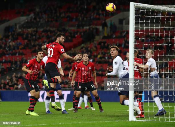 Charlie Austin of Southampton shoots a header and hits the crossbar during the Premier League match between Tottenham Hotspur and Southampton FC at...