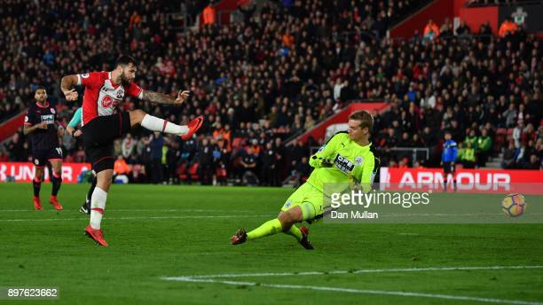 Charlie Austin of Southampton shoots during the Premier League match between Southampton and Huddersfield Town at St Mary's Stadium on December 23...