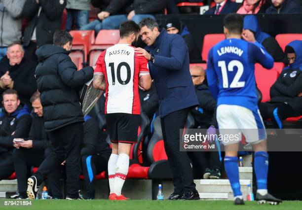 Charlie Austin of Southampton speaks with Mauricio Pellegrino Manager of Southampton as he is substituted during the Premier League match between...