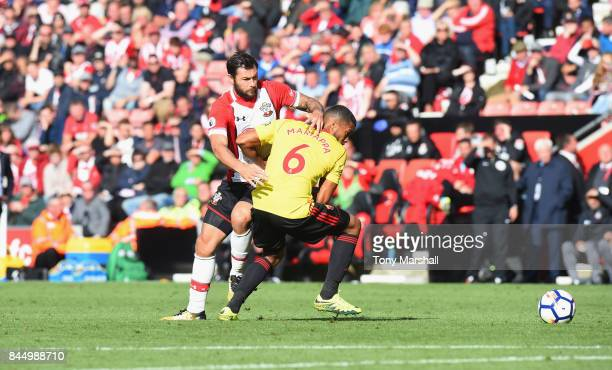 Charlie Austin of Southampton tackles Adrian Mariappa of Watford during the Premier League match between Southampton and Watford at St Mary's Stadium...