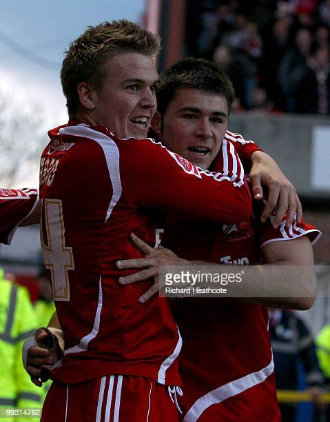 Charlie Austin of Swindon celebrates scoring the opening goal with Danny Ward during the CocaCola League One Playoff Semi Final 1st leg match between...