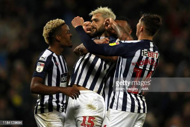 Charlie Austin of West Bromwich Albion celebrates after scoring a goal to make it 21 from the penalty spot with Grady Diangana and Matt Phillips...