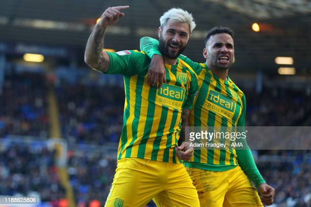 Charlie Austin of West Bromwich Albion celebrates after scoring a goal to make it 22 with Hal RobsonKanu of West Bromwich Albion during the Sky Bet...