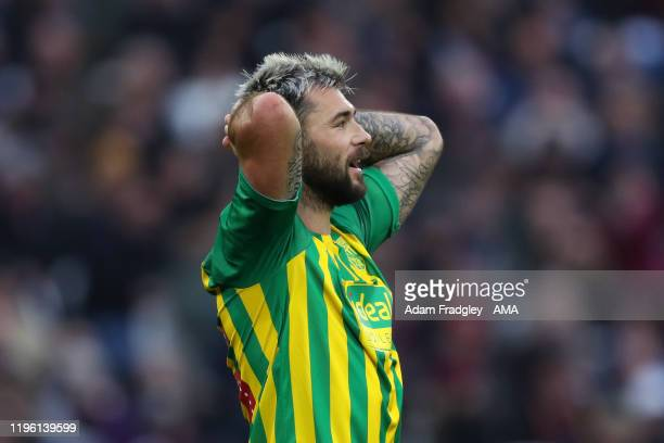 Charlie Austin of West Bromwich Albion reacts after his header is shot wide of the goal during the FA Cup Fourth Round match between West Ham United...