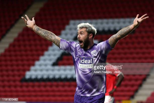 Charlie Austin of West Bromwich Albion reacts as he appeals for handball inside the penalty area that is not given during the FA Cup Third Round...
