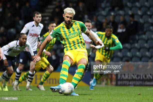 Charlie Austin of West Bromwich Albion scores a goal to make it 0-1 from the penalty spot during the Sky Bet Championship match between Preston North...