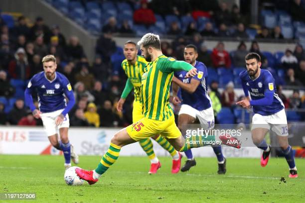 Charlie Austin of West Bromwich Albion scores a goal to make it 1-1 from the penalty spot during the Sky Bet Championship match between Cardiff City...