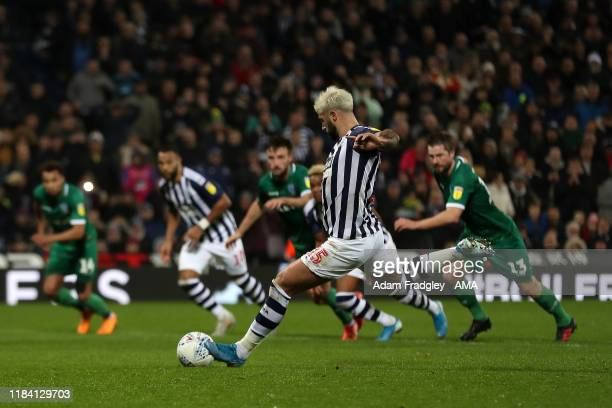 Charlie Austin of West Bromwich Albion scores a goal to make it 21 from the penalty spot during the Sky Bet Championship match between West Bromwich...
