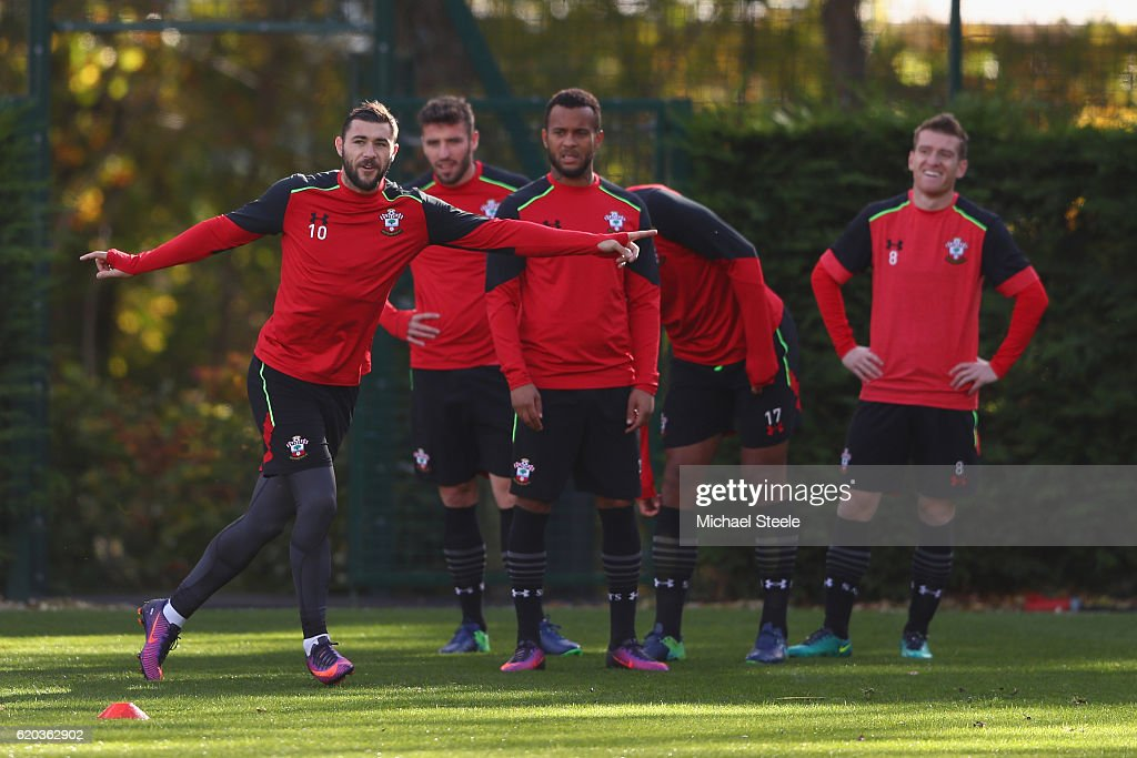 Charlie Austin (L) points the way during the Southampton training session at Staplewood Training Ground on November 2, 2016 in Southampton, England.