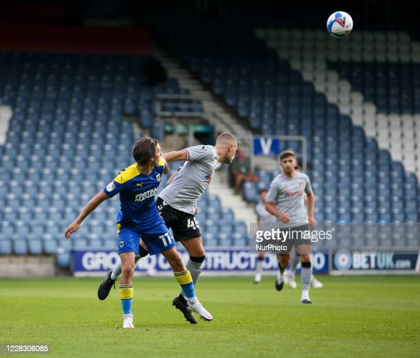 LONDON ENGLAND SEPT 1ST 2020 Charlie Barker of Charlton Athletic battles for possession with Ethan Chislett of AFC Wimbledon during the EFL Trophy...