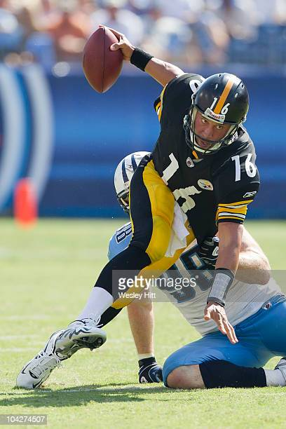Charlie Batch of the Pittsburgh Steelers is sacked by Casey Hampton of the Tennessee Titans at LP Field on September 19 2010 in Nashville Tennessee...