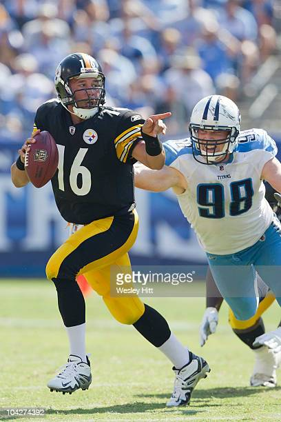 Charlie Batch of the Pittsburgh Steelers points to a receiver while being chased by Casey Hampton of the Tennessee Titans at LP Field on September 19...