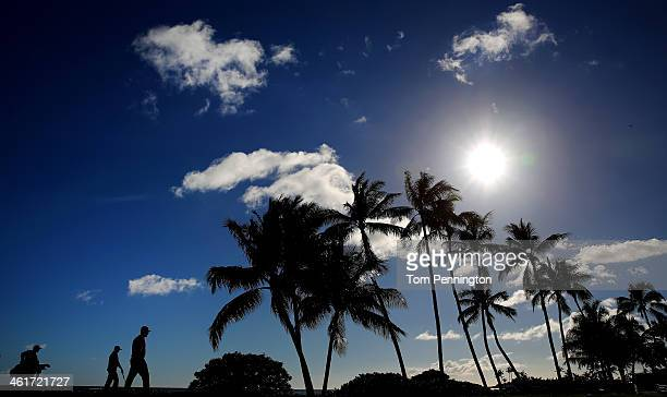 Charlie Beljan and Ted Potter Jr walk down the 17th fairway during the second round of the Sony Open in Hawaii at Waialae Country Club on January 10...