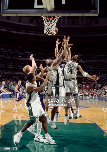 Charlie Bell, Guard for the Michigan State Spartans battles for the rebound during the NCAA Big-10 Conference tournament college basketballl game...
