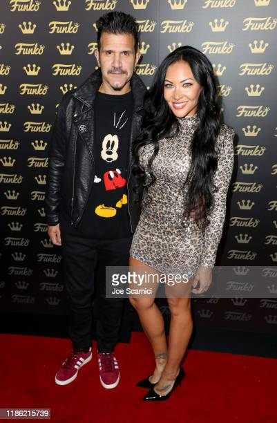 Charlie Benante and guest attend the Funko Hollywood VIP Preview Event at Funko Hollywood on November 07 2019 in Hollywood California