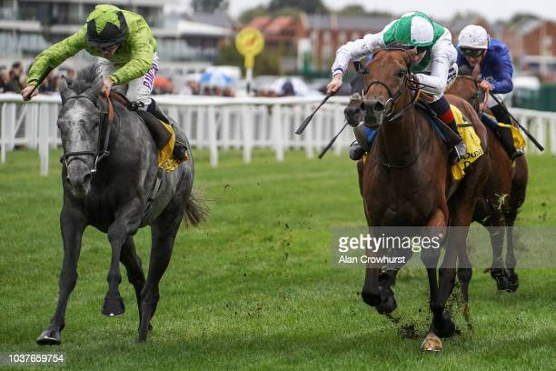 Charlie Bennett riding Buzz win The Dubai Duty Free Handicap Stakes at Newbury Racecourse on September 22 2018 in Newbury United Kingdom
