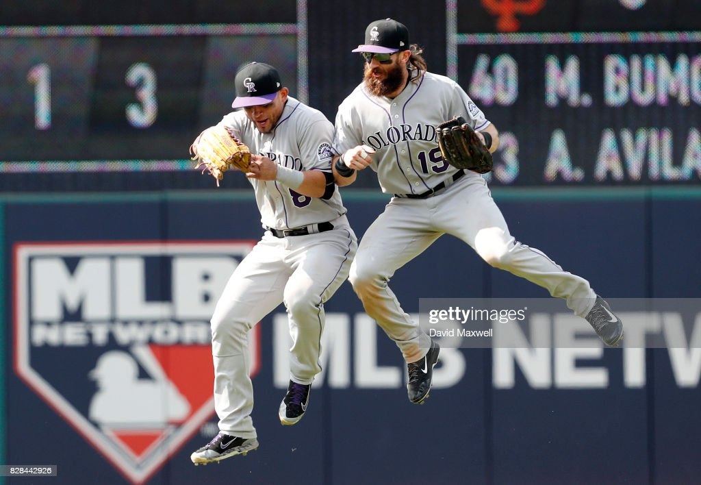 Charlie Blackmon #19 and Gerardo Parra #8 of the Colorado Rockies celebrate after defeating the Cleveland Indians in 12 innings at Progressive Field on August 9, 2017 in Cleveland, Ohio.