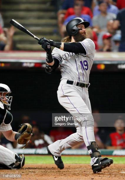 Charlie Blackmon of the Colorado Rockies and the National League hits a solo home run during the sixth inning against the American League during the...