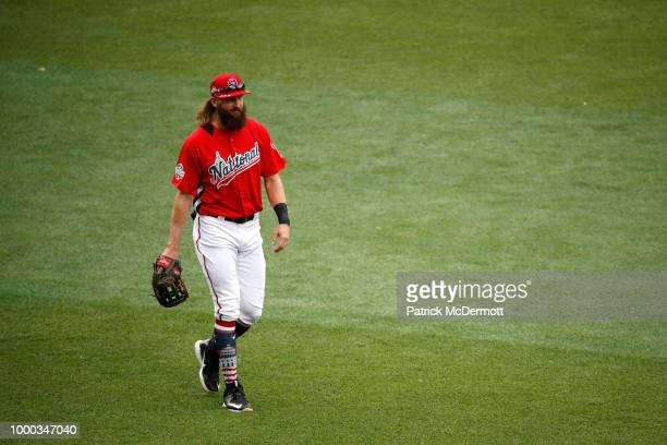Charlie Blackmon of the Colorado Rockies and the National League walks in the outfield during Gatorade AllStar Workout Day at Nationals Park on July...
