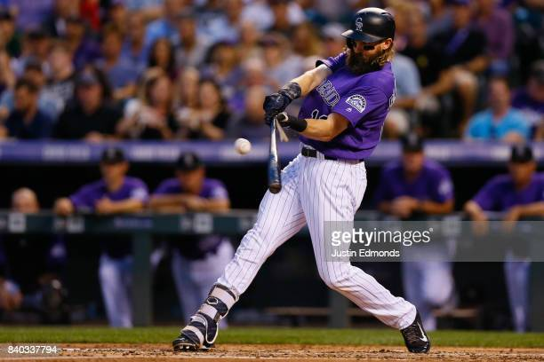 Charlie Blackmon of the Colorado Rockies breaks his bat en route to an RBI single against the Detroit Tigers during the second inning of an...