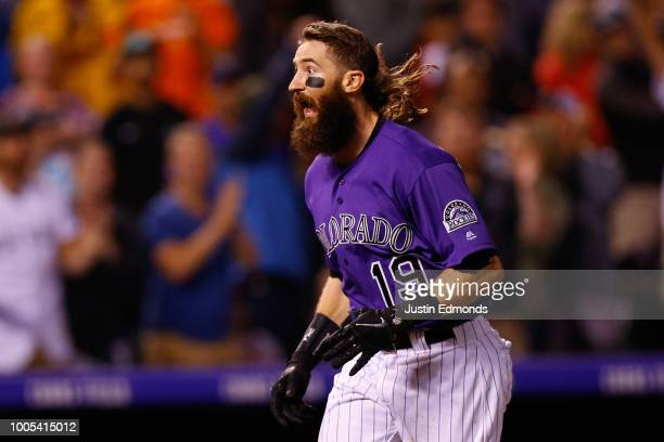 Charlie Blackmon of the Colorado Rockies celebrates his walkoff solo home run in the ninth inning against the Houston Astros during interleague play...