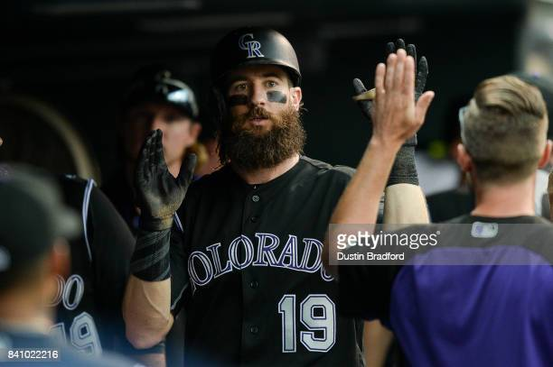 Charlie Blackmon of the Colorado Rockies celebrates in the dugout after hitting a sixth inning solo homerun against the Detroit Tigers at Coors Field...