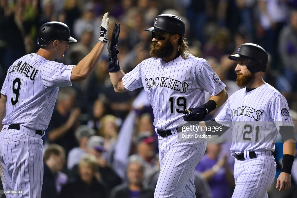 Charlie Blackmon #19 of the Colorado Rockies celebrates with DJ LeMahieu #9 and Jonathan Lucroy #21 after hitting a sixth inning three run homerun against the San Diego Padres at Coors Field on September 16, 2017 in Denver, Colorado.
