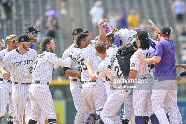 Charlie Blackmon of the Colorado Rockies celebrates with teammates after hitting a ninth inning walk off RBI single against the San Diego Padres at...