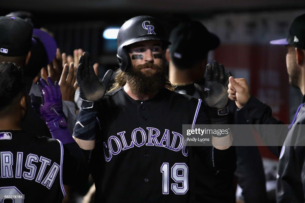 Charlie Blackmon #19 of the Colorado Rockies celebrates with teammates after scoring in the ninth inning against the Cincinnati Reds at Great American Ball Park on May 19, 2017 in Cincinnati, Ohio.