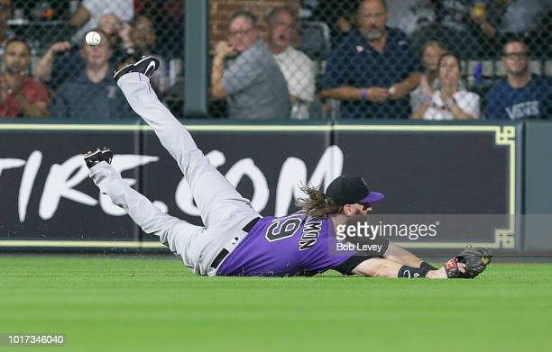 Charlie Blackmon of the Colorado Rockies dives but is unable to make a catch on a line drive by Alex Bregman of the Houston Astros in the first...