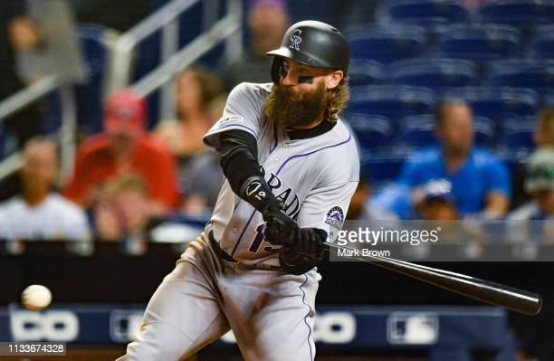 Charlie Blackmon of the Colorado Rockies doubles for an rbi in the seventh inning during the game against the Miami Marlins at Marlins Park on March...