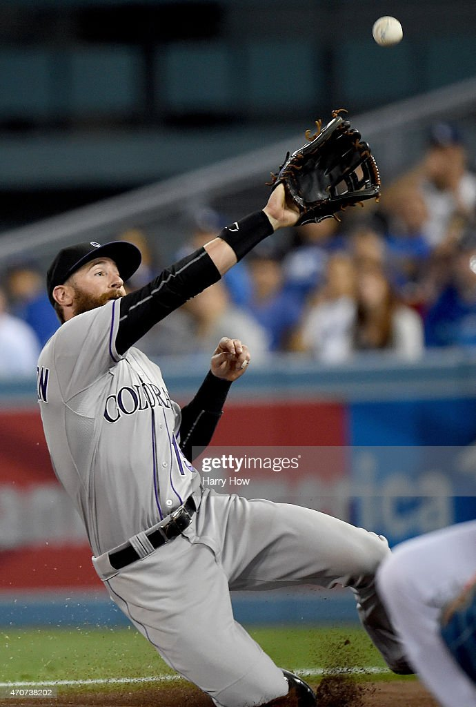 Charlie Blackmon #19 of the Colorado Rockies drops a ball in foul territory off the bat of Jimmy Rollins #11 of the Los Angeles Dodgers during the third inning at Dodger Stadium on April 17, 2015 in Los Angeles, California.