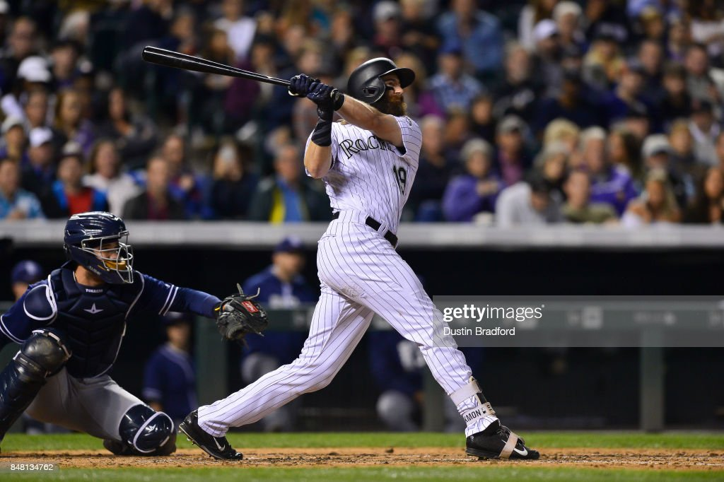Charlie Blackmon #19 of the Colorado Rockies follows the flight of a sixth inning three run homerun against the San Diego Padres at Coors Field on September 16, 2017 in Denver, Colorado.