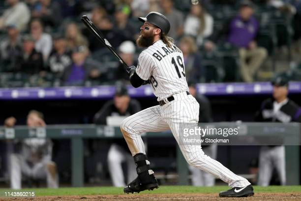 Charlie Blackmon of the Colorado Rockies hits a 2 RBI walk off home run in the 12th inning against the Philadelphia Phillies at Coors Field on April...