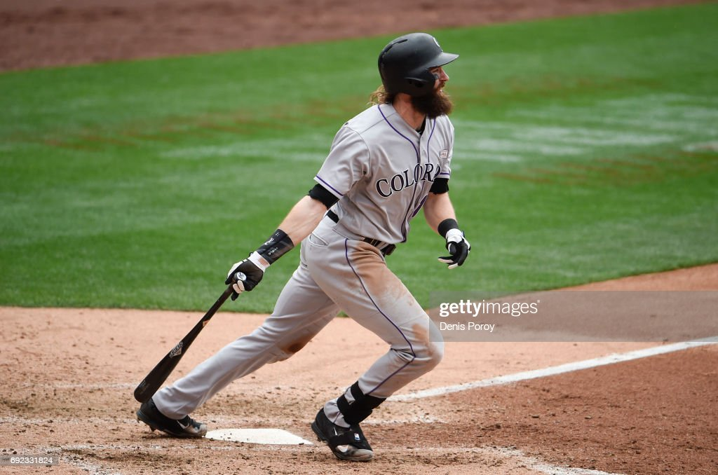 Charlie Blackmon #19 of the Colorado Rockies hits a double during the seventh inning of a baseball game against the San Diego Padres at PETCO Park on June 4, 2017 in San Diego, California.