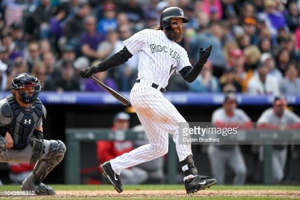 Charlie Blackmon of the Colorado Rockies hits a eighth inning RBI double to complete the cycle against the Washington Nationals at Coors Field on...