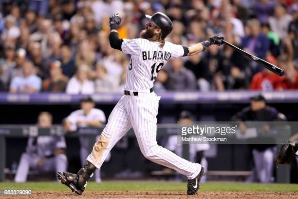 Charlie Blackmon of the Colorado Rockies hits a home run in the eighth inning against St Louis Cardinals at Coors Field on May 26 2017 in Denver...