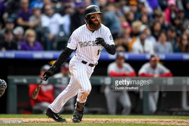 Charlie Blackmon of the Colorado Rockies hits a ninth inning RBI double to complete the cycle against the Washington Nationals at Coors Field on...